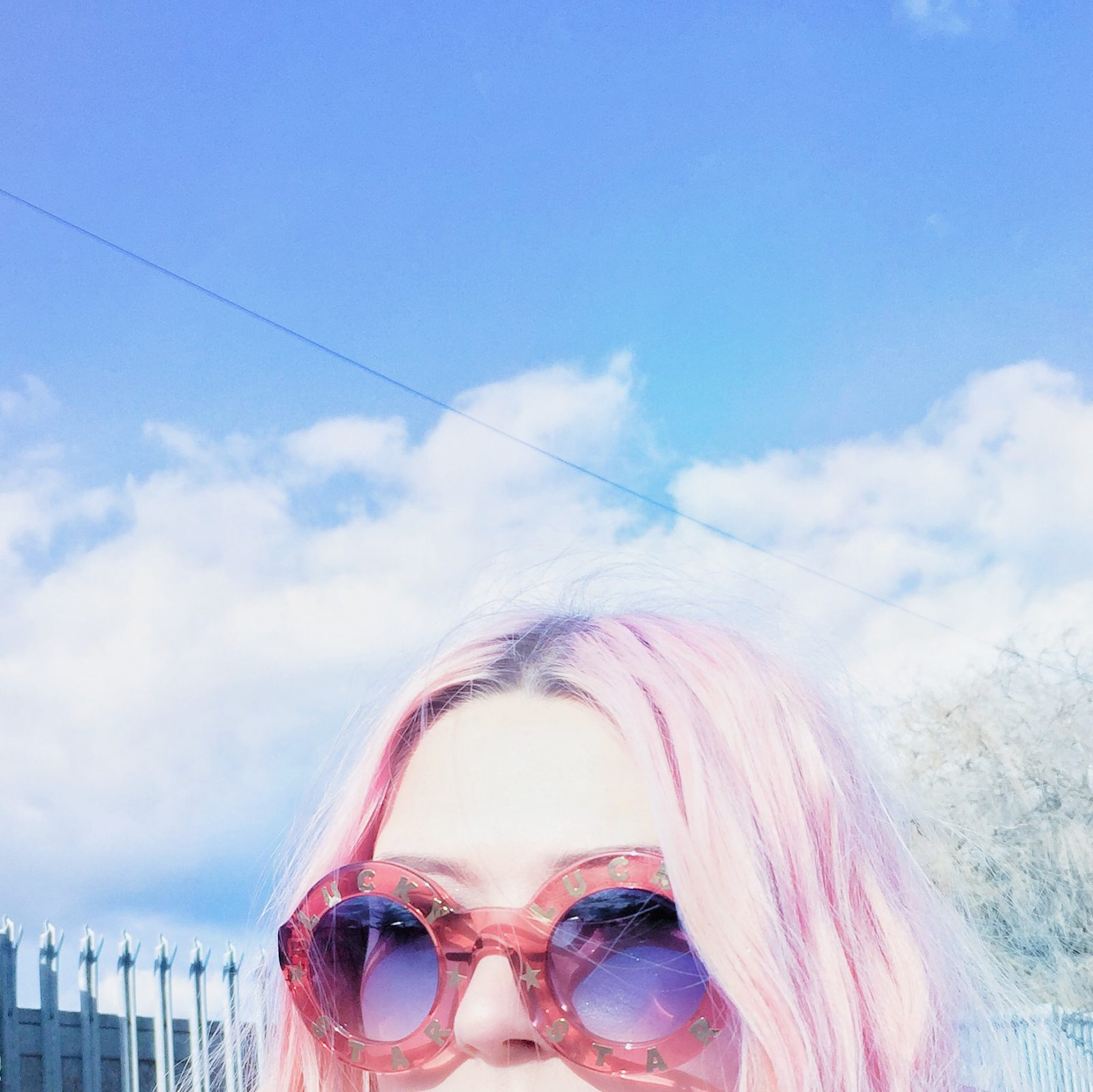 pink puffer jacket, MISSGUIDED JACKET, poppy lissiman sunglasses, festival shorts, pink hair, purple hair, alt blogger
